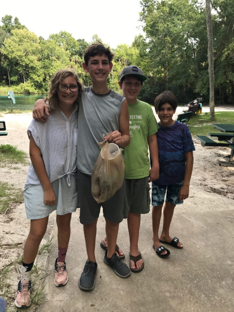 teens showing trash picked up at Alexander Springs