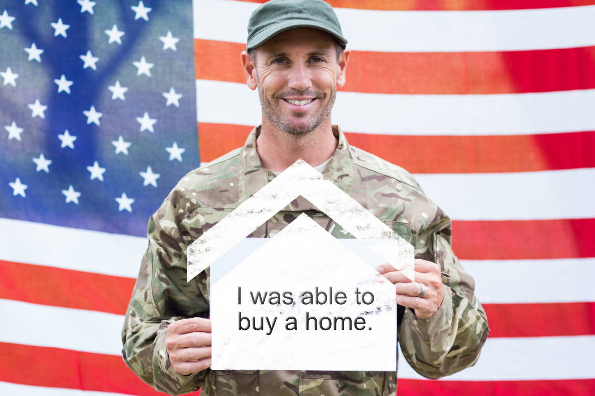 Veteran holding sign saying he bought a home