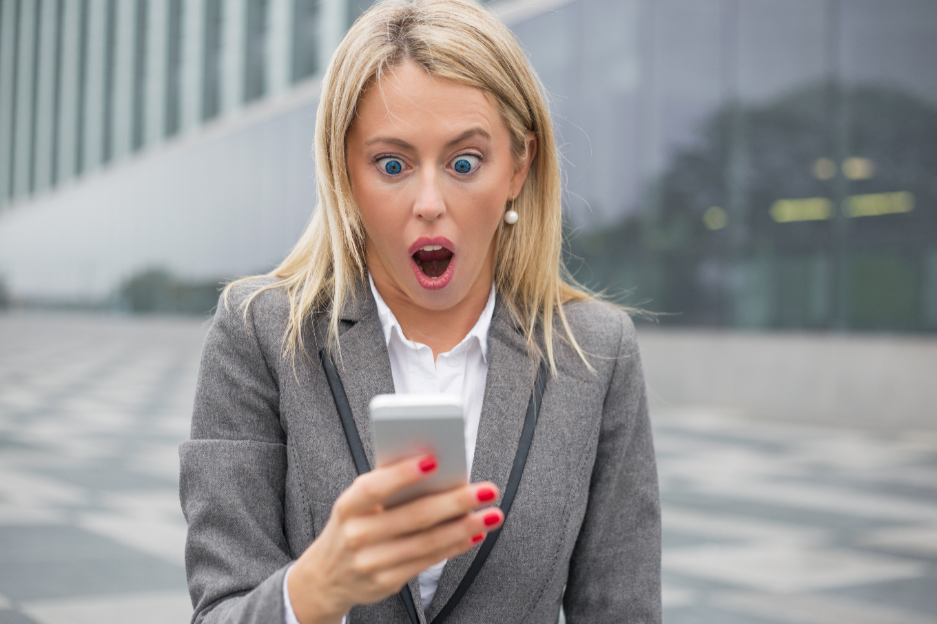 surprised woman shocked by what she sees on her phone