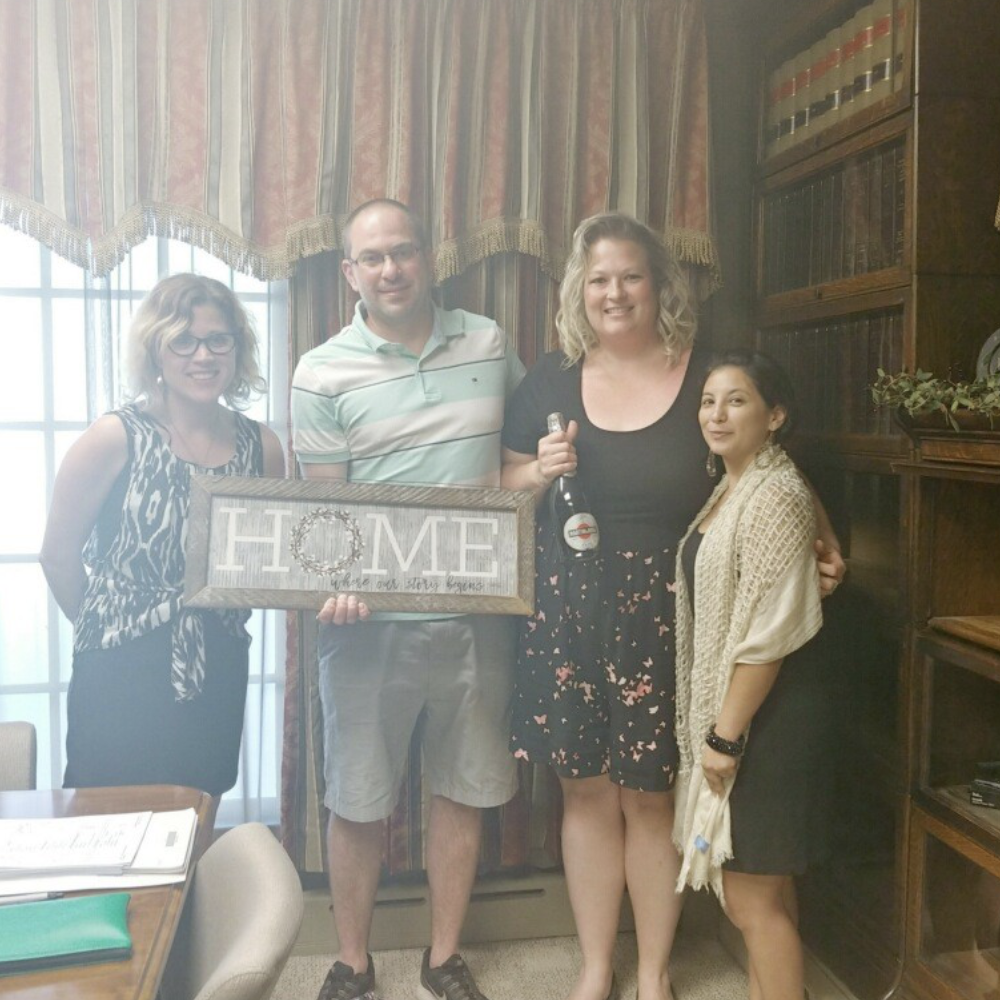 New home buyers closing on their new home