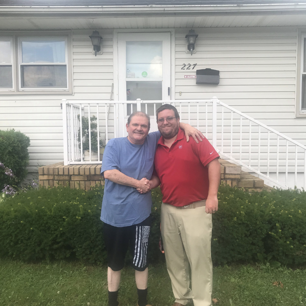 First time home buyer outside his new house