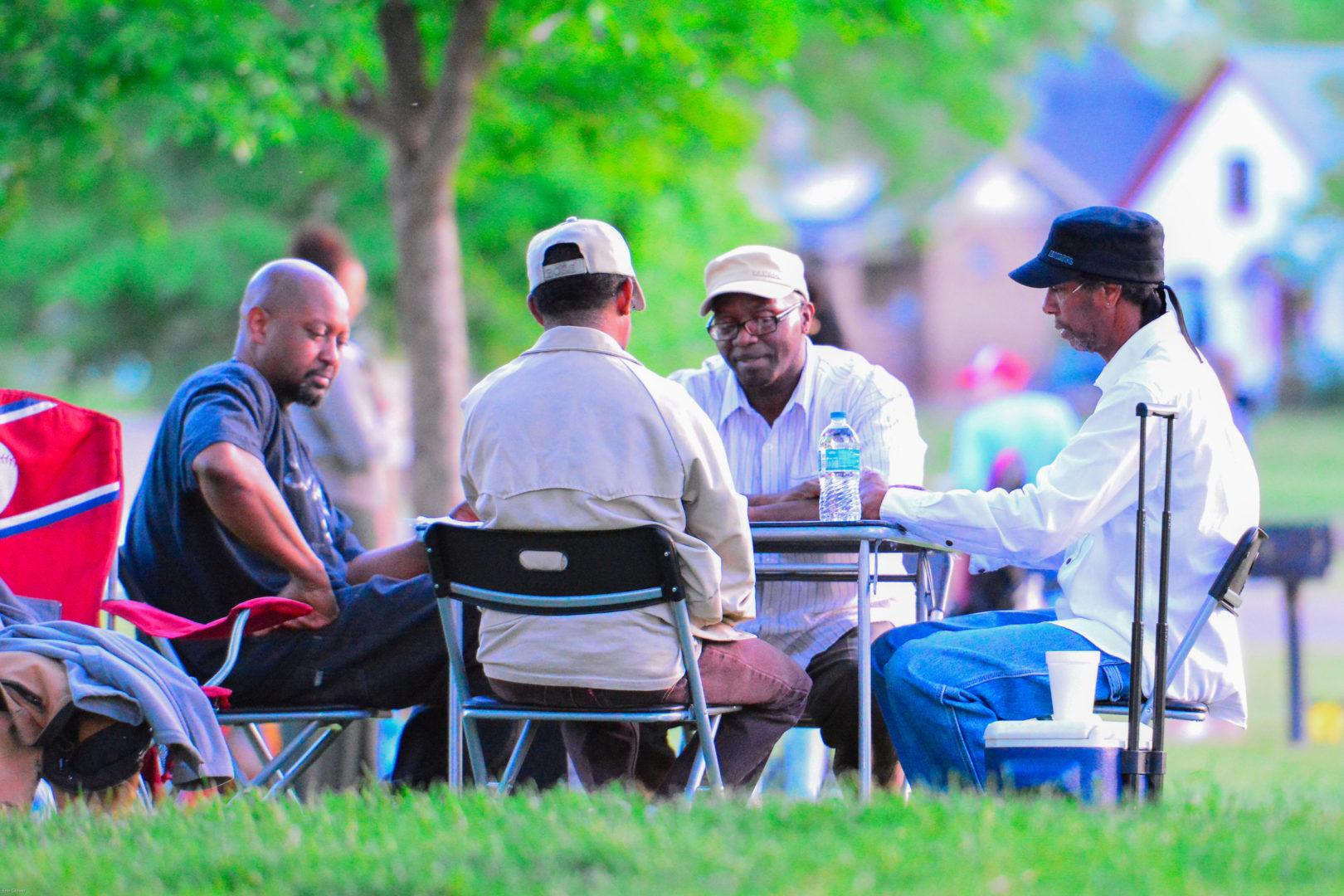 Men Playing A Game - Erin Glover