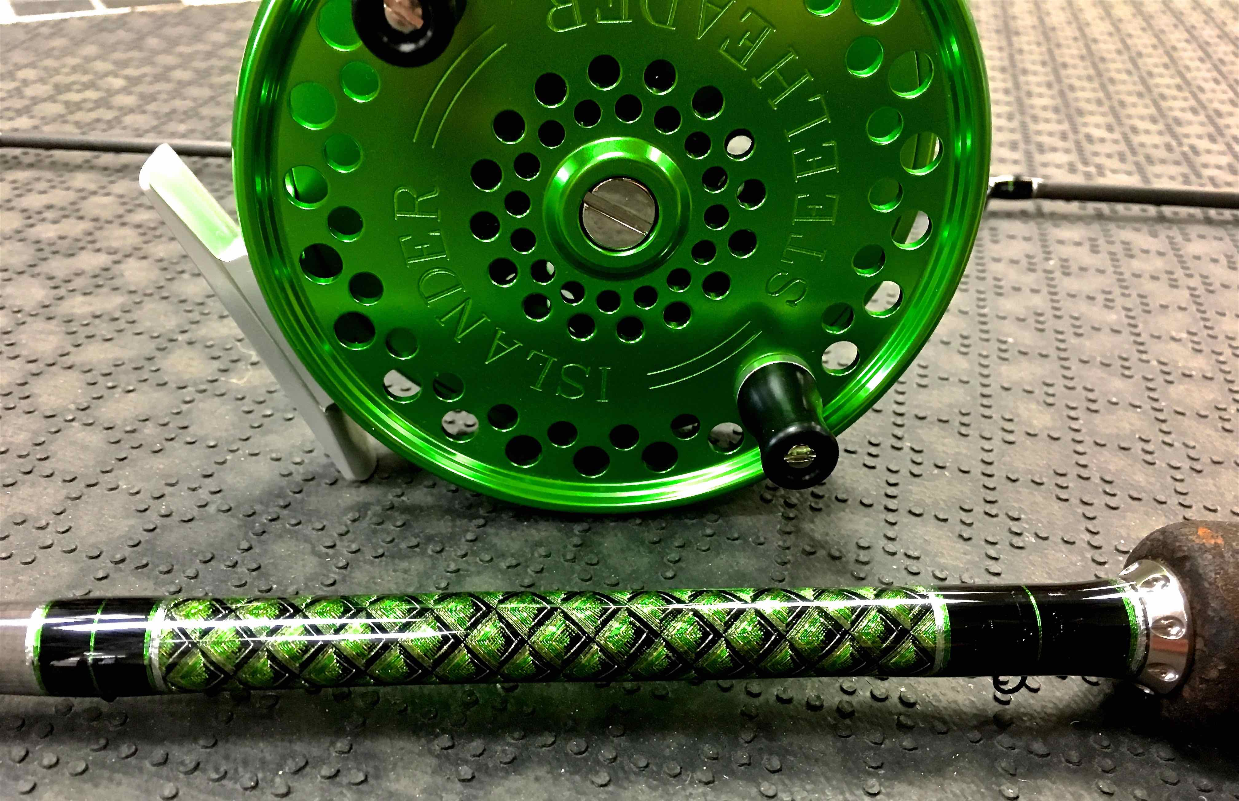 A Northfork Composites 1302HM with a Custom Butt Wrap and a Custom Green Islander Steelheader.