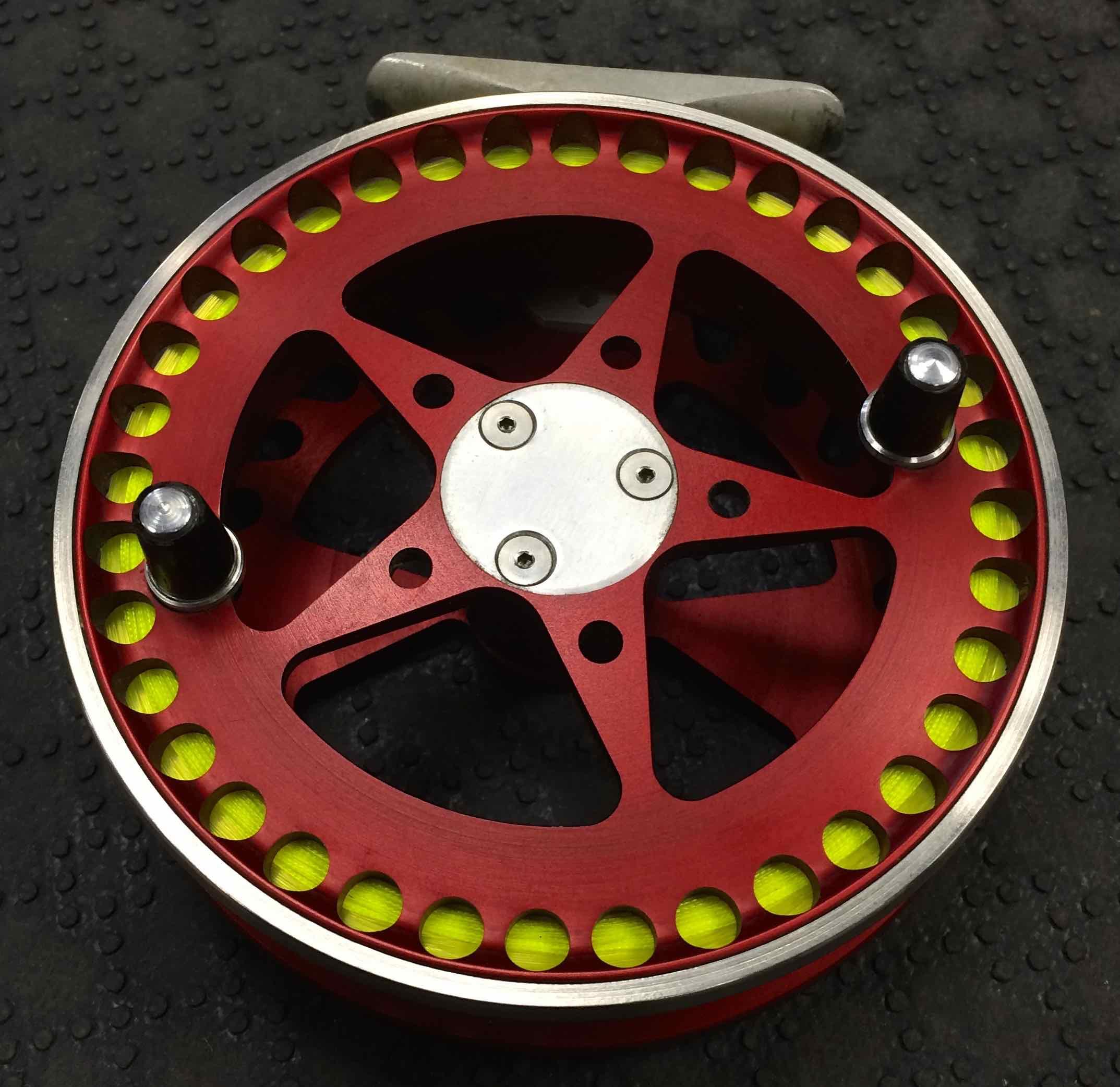 Custom HLS Float Reel Rosewood Handles Slainless Palming Ring Red Front Resized for Web
