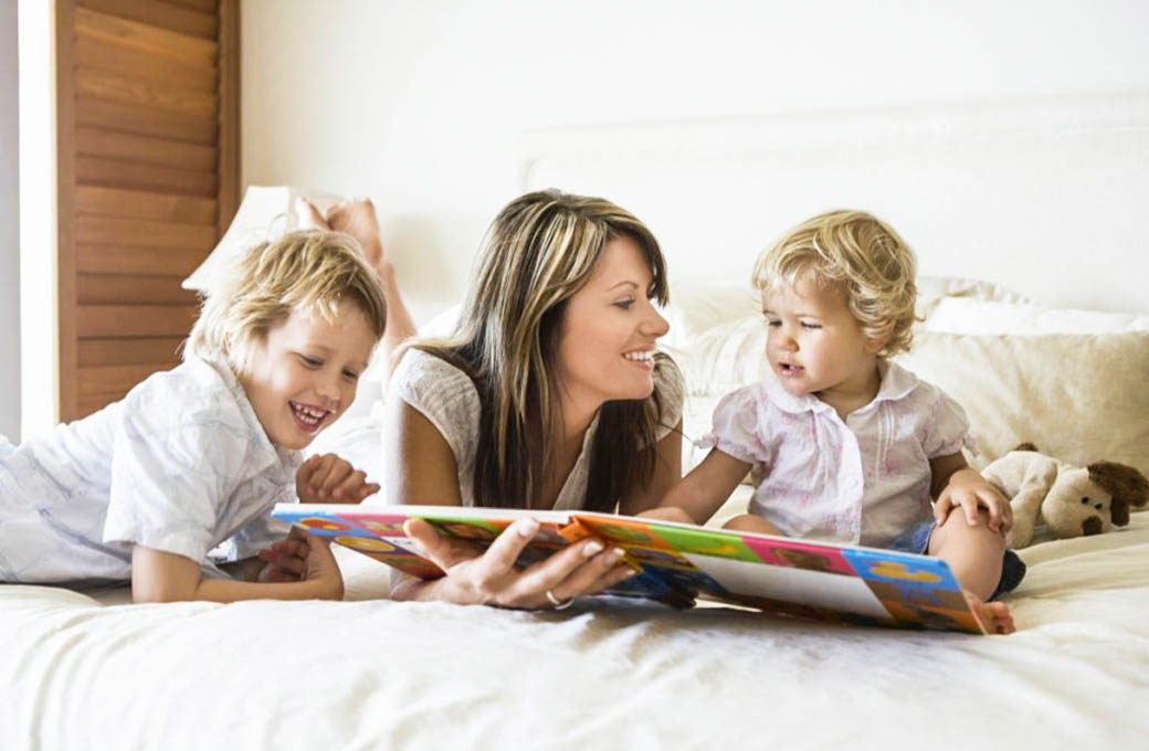 mother reading to kids babysitter