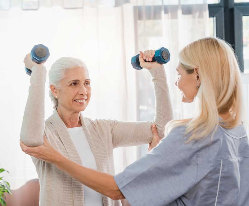 patient getting rehab care from nurse