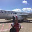 Kid in front of Virgin Airlines