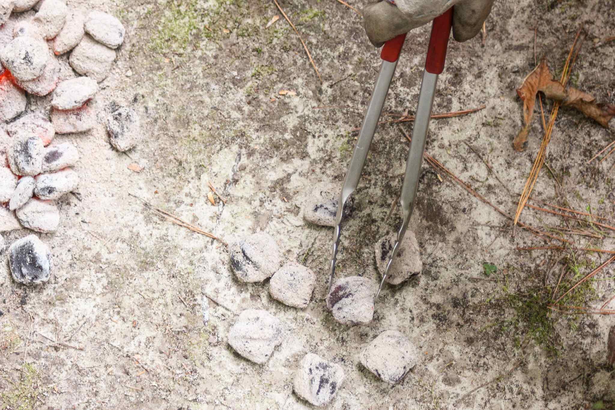 placing bottom coals