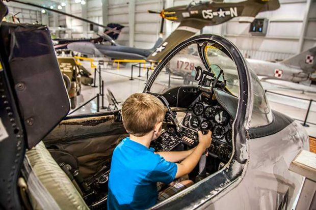 Boy in a plane cockpit at the Tennessee Museum of Aviation