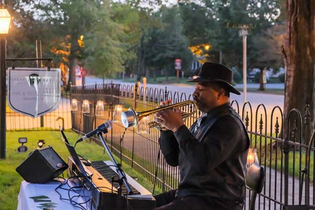 Musician Wayne James plays trumpet for a crowd in Edenton