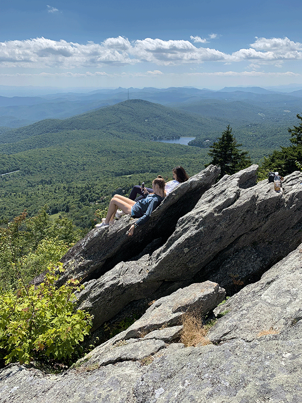 Teens relaxing on Grandfather Mountain