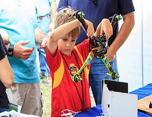 MAKER FAIRE BOY WITH DRONE