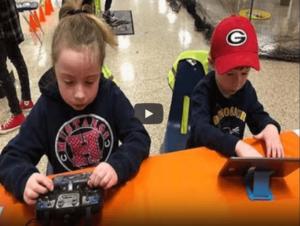 kids on drone simulators