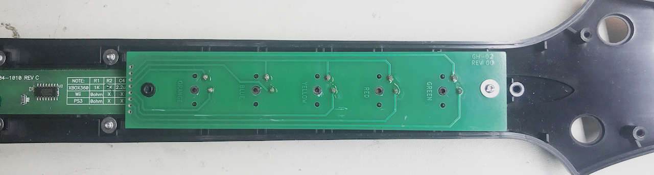Fret PC Board resting on the fret buttons