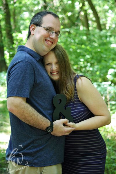 Happy couple in engagement photo.