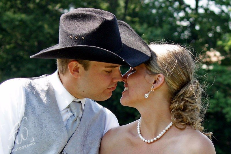 Kissing married couple - wedding photography