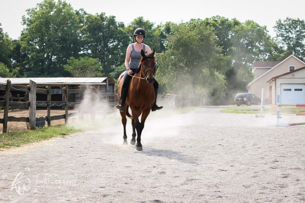 Kellie riding Niko, leaving a trail of dust behind!
