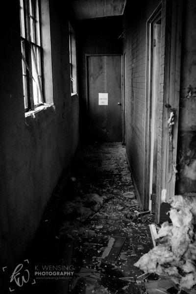 Black and white photo of creepy hallway.