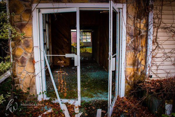 Opened doors to a building of decay.