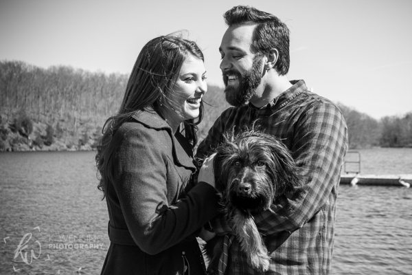Laughing couple with their dog.