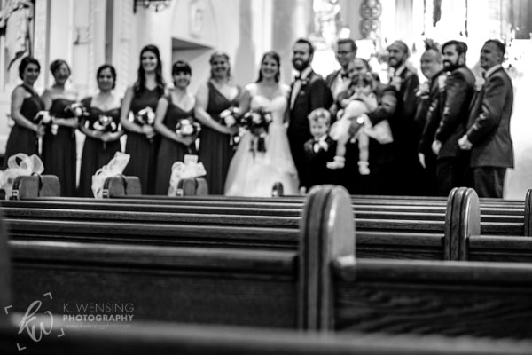 Group shot of bridal party inside the church.