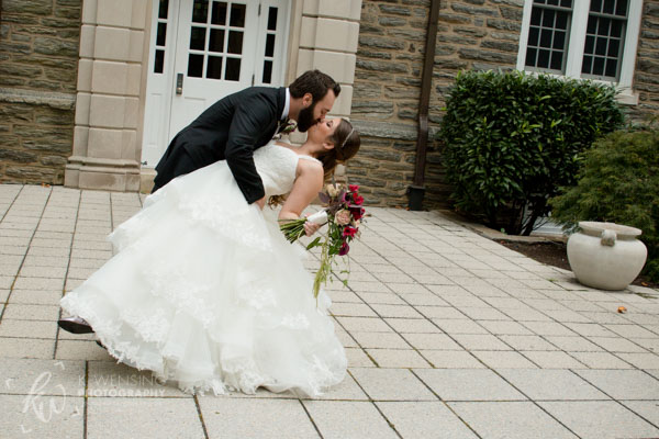A traditional bride and groom kiss.