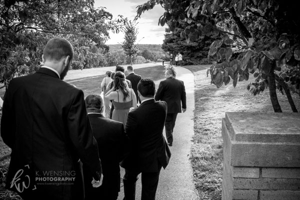 Black and white photograph of the walking wedding party.