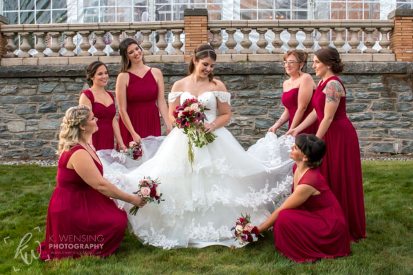 The beautiful bride posing with her bridesmaids.