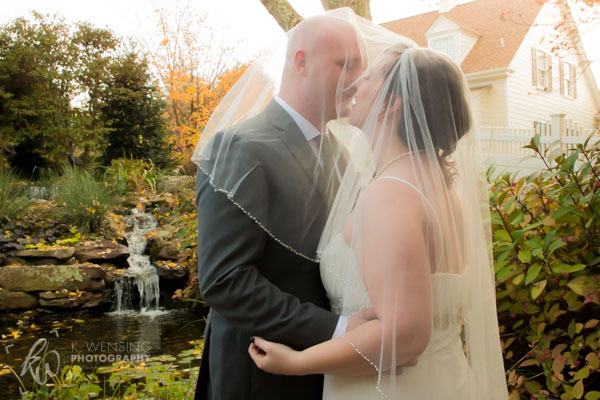A kiss underneath the bridal veil.