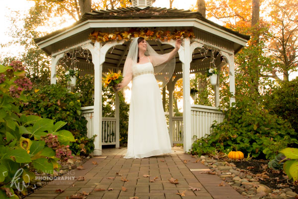 Posing bride at the gazebo.