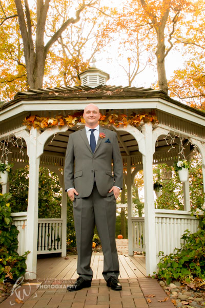 Groom standing at the gazebo.