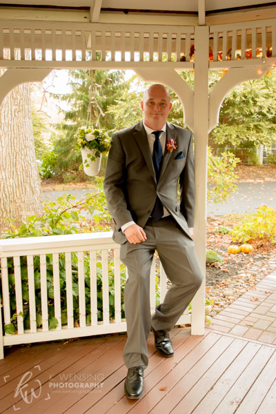 Groom posing on his wedding day.