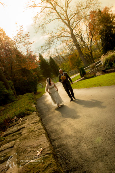 Married couple walking the path on a beautiful Fall day.