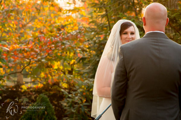 Bride smiling at her husband during the ceremony.