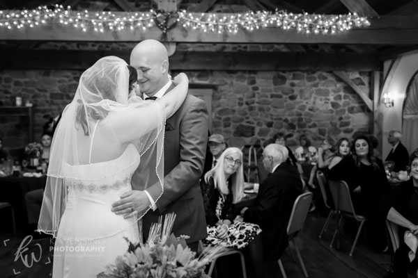 Black and white photo of couple during their first dance.