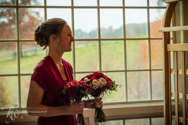 The lovely bridesmaid watching the ceremony.