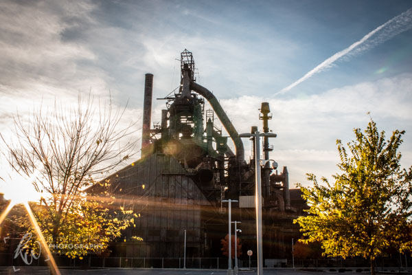 The sun descends behind the Bethlehem Steel plant.