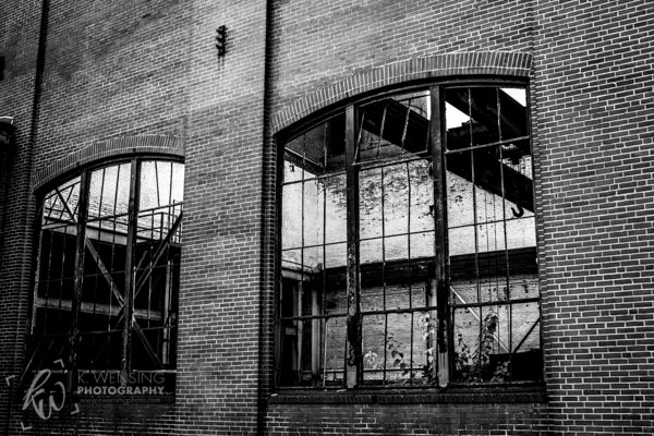 Gazing through the windows of an old building at SteelStacks.