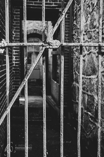 Black and white photograph of a penitentiary gate.