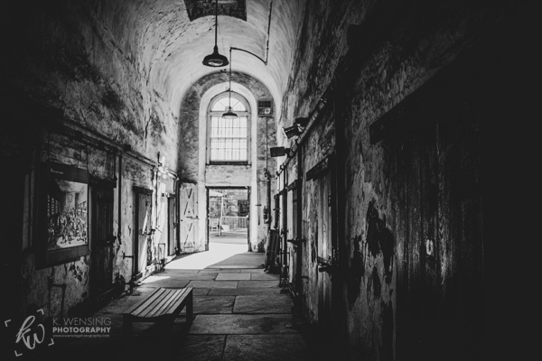 Black and white photo of an old cell block.