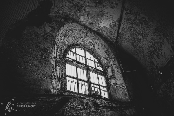 Black and white photo of a window in the Eastern State Penitentiary.