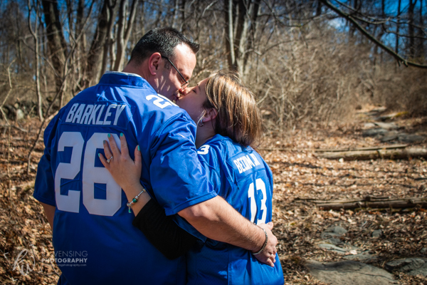 Kissing couple in football jerseys.