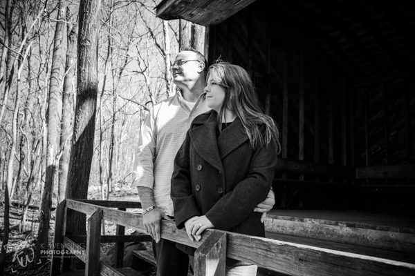 Black and white photo of couple looking out over the wilderness.