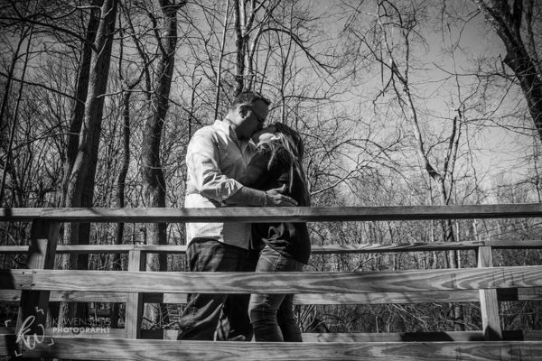 Kissing each other on a bridge.
