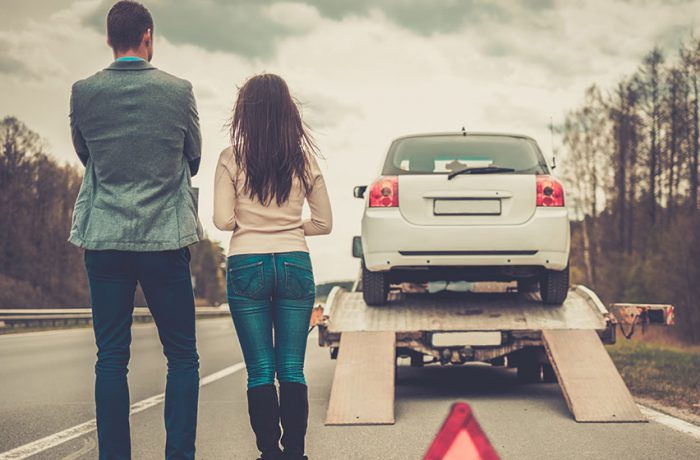 Couple using their vehicle insurance policy