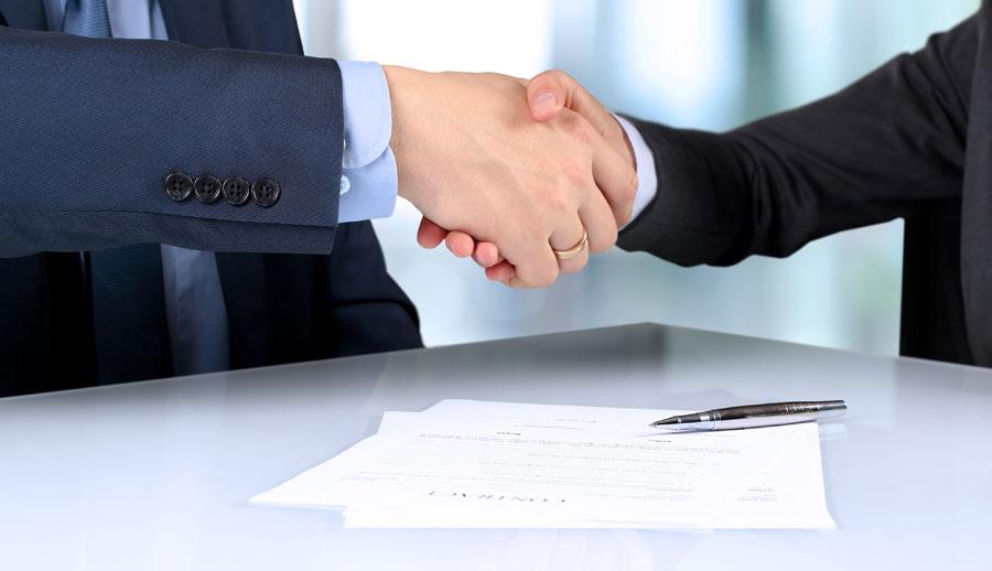 People signing contract