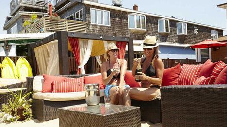 Two women relaxing in the palms courtyard