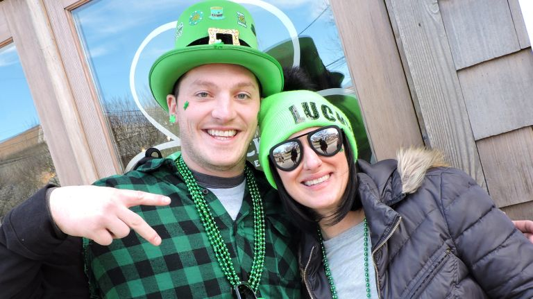 two friends celebrating St. Pattys day at CJ's