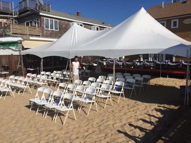 party tent with seating on the beach