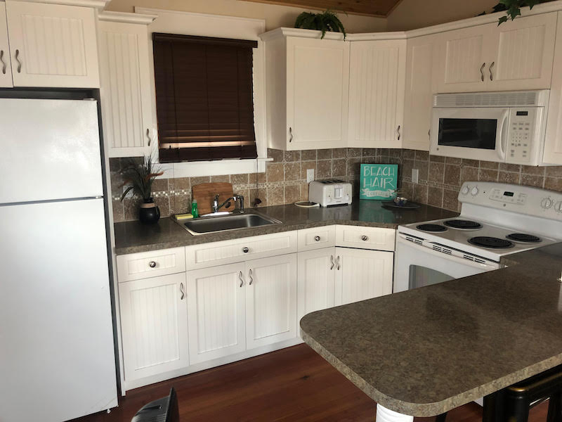 full kitchen with fridge and oven